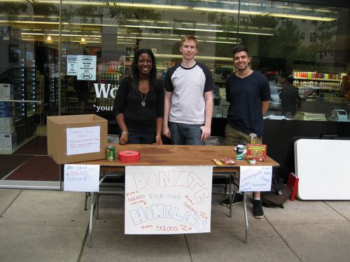 Rob Anzenberger, Brittany Golden, and Colin Pugh at their Food Drive Table